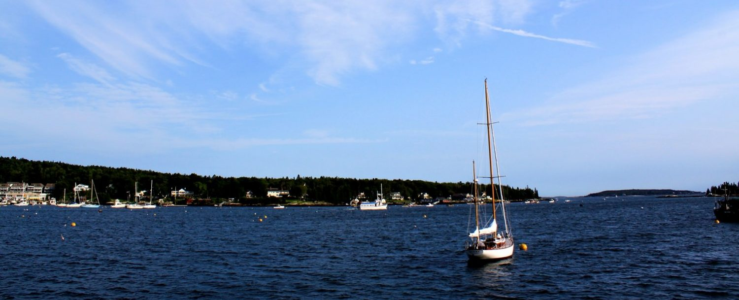 A sailboat on the water in Boothbay Harbor