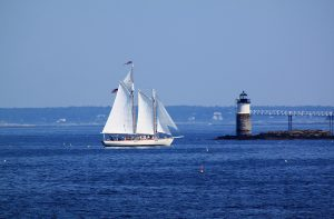 Sail boat at a lighthouse in Boothbay Harbor, Maine