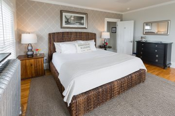 Room 4, Main Guest House, King bed in a dark frame with luxury frame mattress