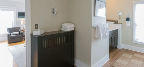 Large private bathroom with two vanities and plenty of sunshine