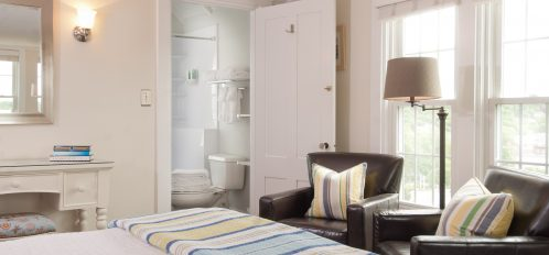 Room 6, Main Guest House, King bed with a luxury firm mattress and private bath with tub shower combination