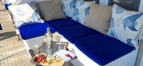 Enjoy local wines and hand crafted cheese boards and charcuterie on the covered sitting porch and its comfortable couch