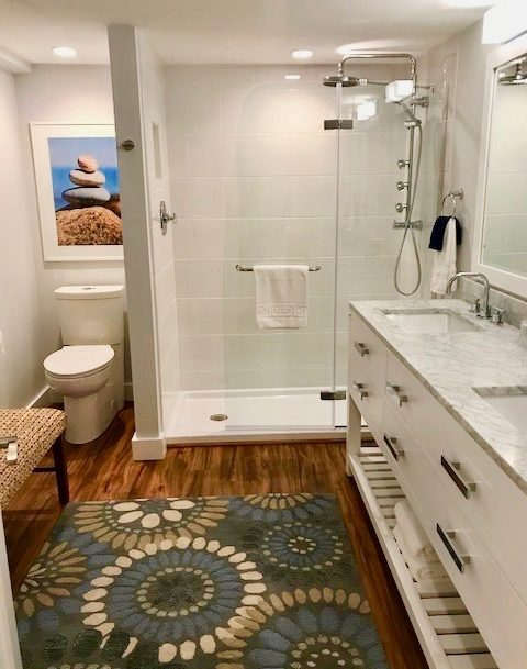Beautiful spacious custom bathroom with double vanities and walk-in shower