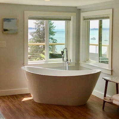 Luxury soaking tub with stunning views of the harbor