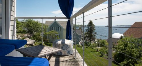 Coveted corner room boasts some of the best views on property, especially from the covered sitting porch.