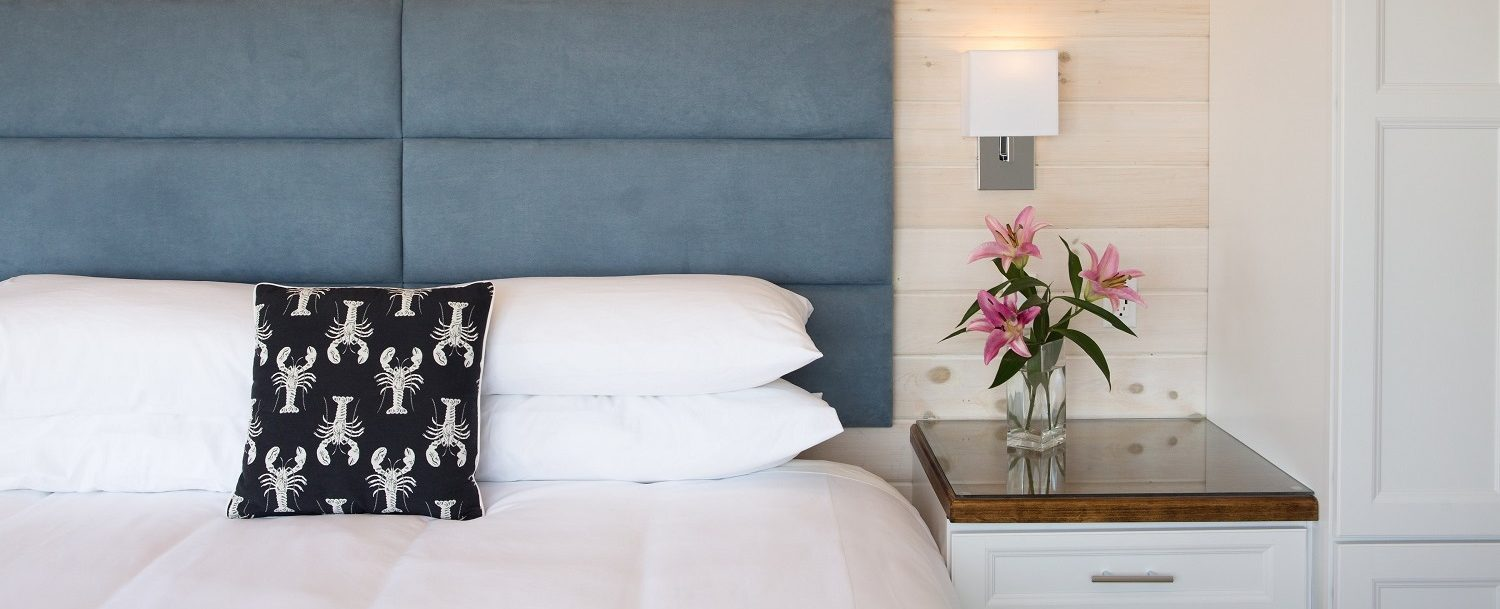 King bed with luxury firm mattress and custom headboard