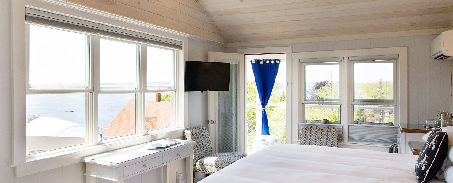 Corner room on the 2nd floor of the Windward Guest House, with plenty of sunshine and spectacular harbor views.