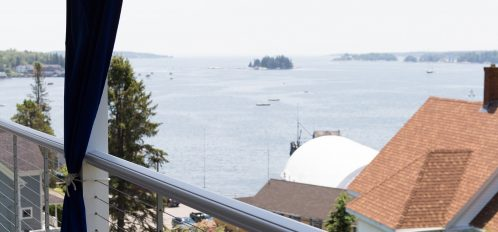 Enjoy stunning harbor views from the covered sitting porch