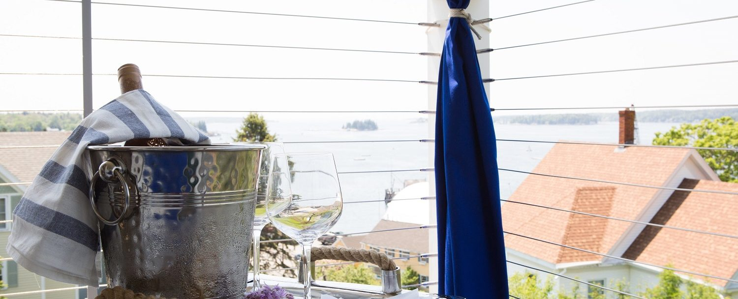 Covered sitting porch with harbor views an ideal spot for an afternoon snack