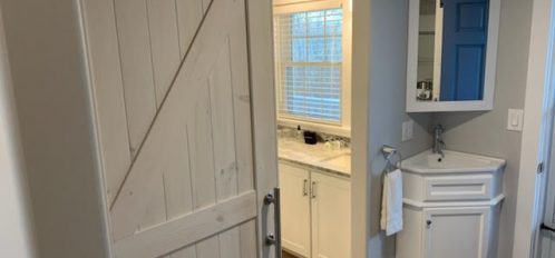 Dual vanities and sliding barn door