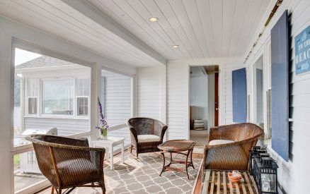 The screened-in porch is a great place to soak up the summer