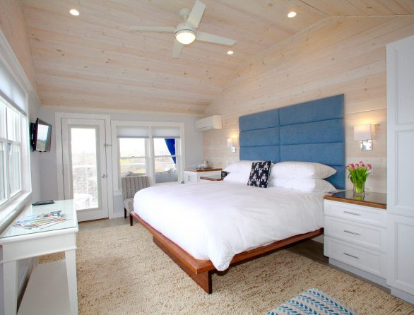 Guest room at the Topside Inn, full of natural light and modernly designed