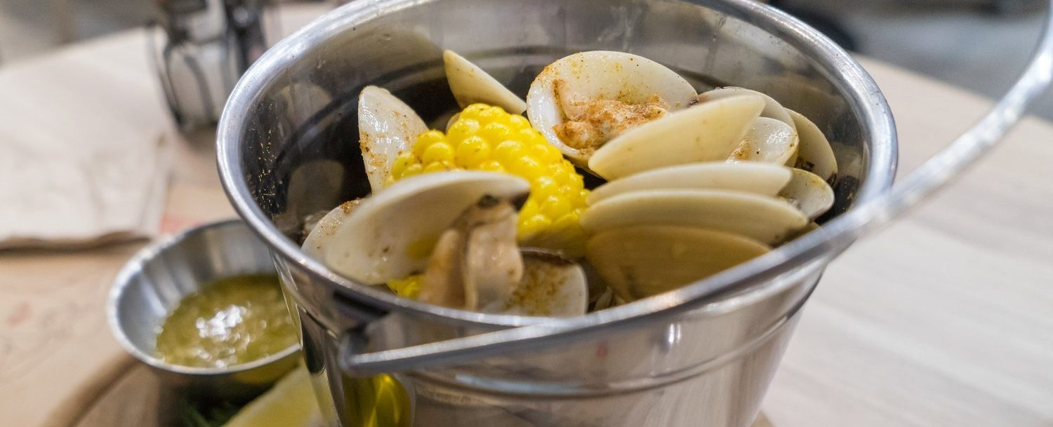 Bucket of steamed clams and corn at Cabbage Island Clambakes