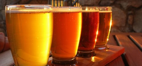 Enjoy a flight of beer at Oxbow Brewing Company.