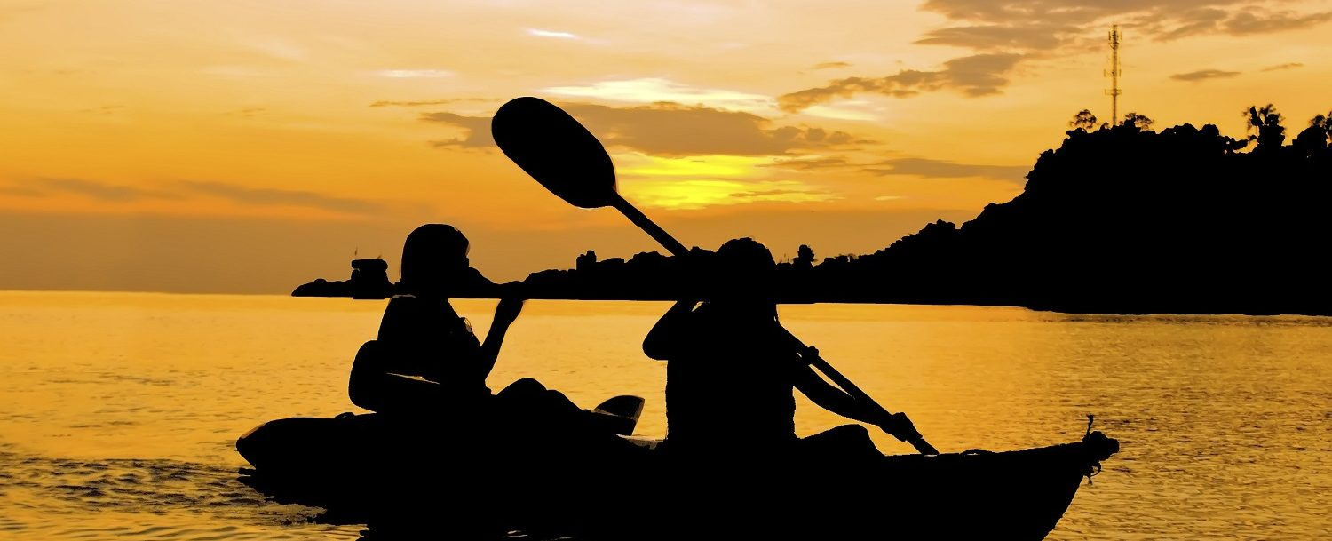 Couple enjoying a sunset tour with Tidal Transit Kayak Company