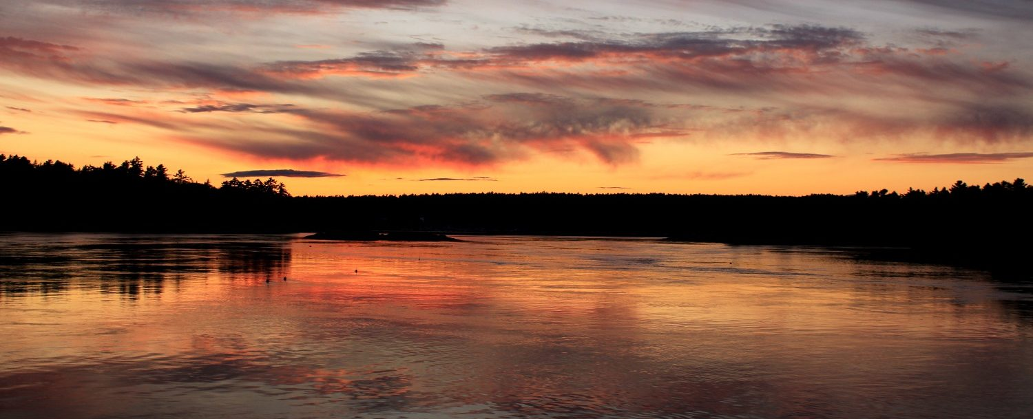 Enjoy a beautiful sunset over the water as part of our Maine vacation packages
