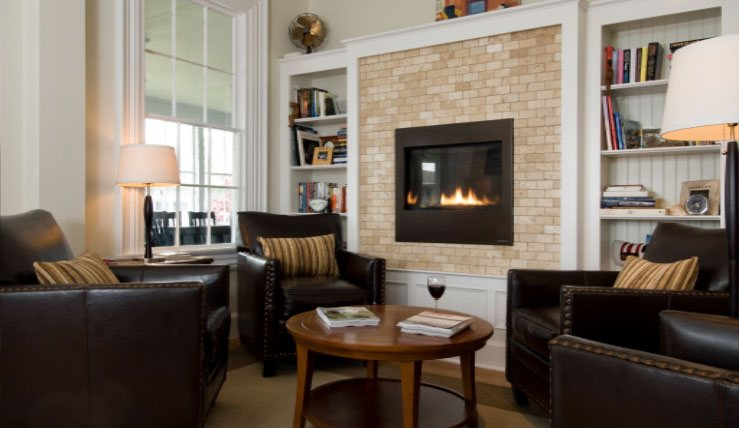 fireplace with chairs in front of it at topside inn