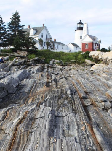cliff with lightouse in boothbay harbor