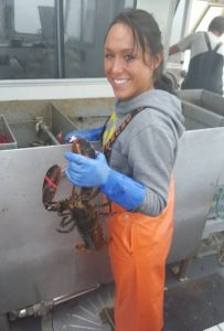 A woman holding a lobster