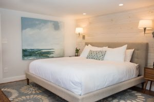 This junior suite boast a luxury firm king mattress and artwork from local artisits