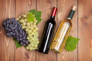 Wine bottles and grapes from the best wineries in Maine