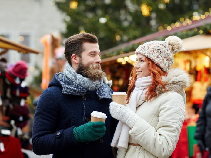 Couple at a holiday festival during Christmas in Maine