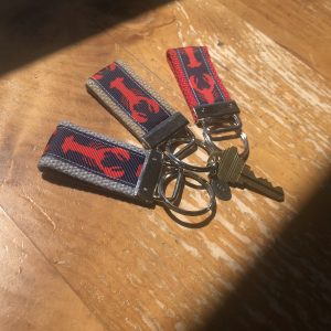 Topside Inn branded key-chain featuring embroidered lobster