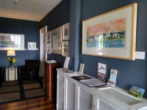 Wood cut artwork by Villard Studios featured at the Topside Inn