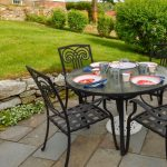 Outdoor stone patio with dining, perfect for afternoon grilling