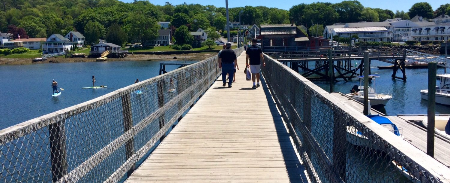People walking across the footbridge in Boothbay Harbor, Maine