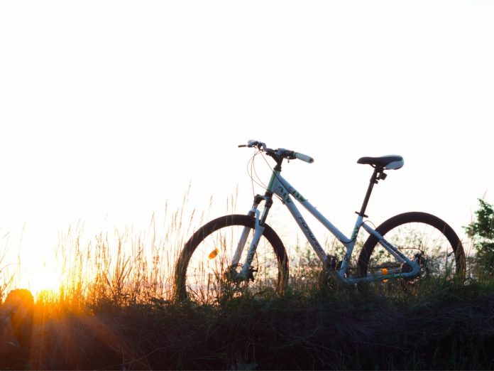 A bike on a hill during sunset in Midcoast Maine